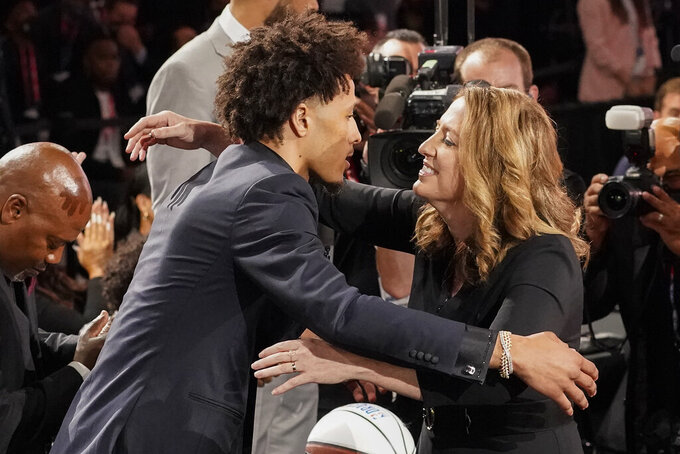 Cade Cunningham, left, hugs family and friends after being selected as the number one draft pick overall by the Detroit Pistons during the NBA basketball draft, Thursday, July 29, 2021, in New York. (AP Photo/Corey Sipkin)