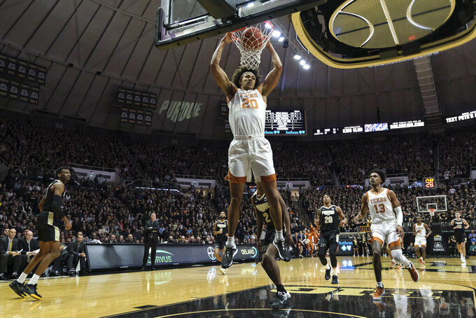 Texas forward Jericho Sims (20) completes a break away dunk against Purdue in the first half of an NCAA college basketball game in West Lafayette, Ind., Saturday, Nov. 9, 2019. (AP Photo/AJ Mast)