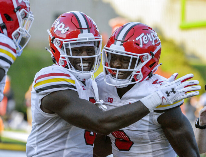 Maryland's Rakim Jarrett celebrates scoring a touchdown with teammate Chigoziem Okonkwo during the second half of an NCAA college football game against West Virginia Saturday, Sept. 4, 2021 in College Park, Md. (Kevin Richardson/The Baltimore Sun via AP)