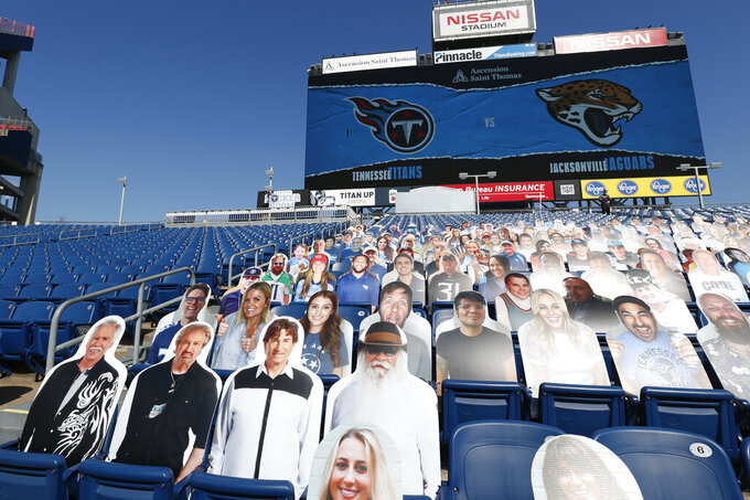Cardboard cutouts of the country music quartet The Oak Ridge Boys, lower left, fill seats in Nissan Stadium before an NFL football game between the Tennessee Titans and the Jacksonville Jaguars Sunday, Sept. 20, 2020, in Nashville, Tenn. (AP Photo/Wade Payne)