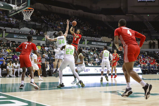 Houston'sCaleb Mills shoots over South Florida's Antun Maricevic (34) during the first half of an NCAA college basketball game Wednesday, Feb. 12, 2020, in Tampa, Fla. (AP Photo/Mike Carlson)