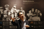 Film director Kim Deog-Young speaks near the exhibition hall of Korean War during an interview in Seoul, South Korea Friday, May 29, 2020. During and after the 1950-53 Korean War, North Korea sent thousands of orphans it couldn't feed to Eastern European communist allies. The children entered schools in Poland, Bulgaria, Romania and elsewhere, forming friendships, studying, playing. Kim's new South Korean documentary film, set to be released this month, sheds light on this mostly forgotten chapter of Cold War history using interviews with the North Koreans' surviving European classmates and teachers.(AP Photo/Lee Jin-man)