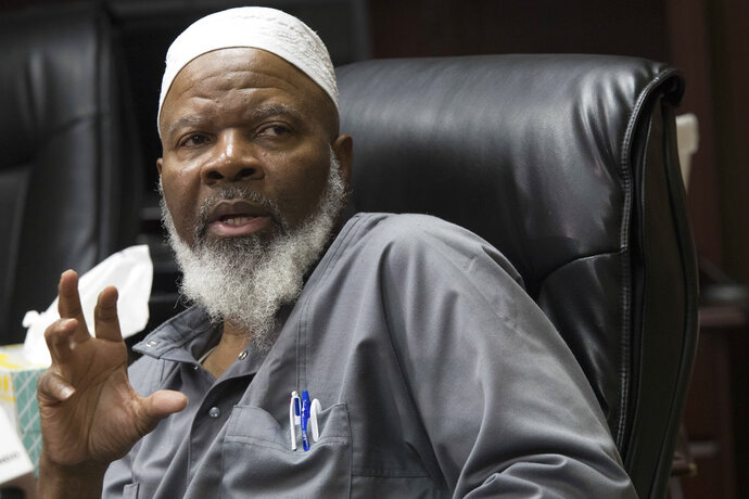 Imam Siraj Wahhaj speaks to reporters, Thursday, Aug. 9, 2018, in New York. Wahhaj, the grandfather of a missing Georgia boy,  says the remains of the child were found buried at a desert compound in New Mexico. Abdul-ghani Wahhaj was found Monday, on what would have been his fourth birthday, after he went missing in December in Jonesboro, Ga. near Atlanta.  (AP Photo/Mary Altaffer)