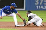 Baltimore Orioles' Cedric Mullins, right, steals second base ahead of the tag by Toronto Blue Jays' Marcus Semien during the first inning of a baseball game Tuesday, Aug. 31, 2021, in Toronto. (Jon Blacker/The Canadian Press via AP)