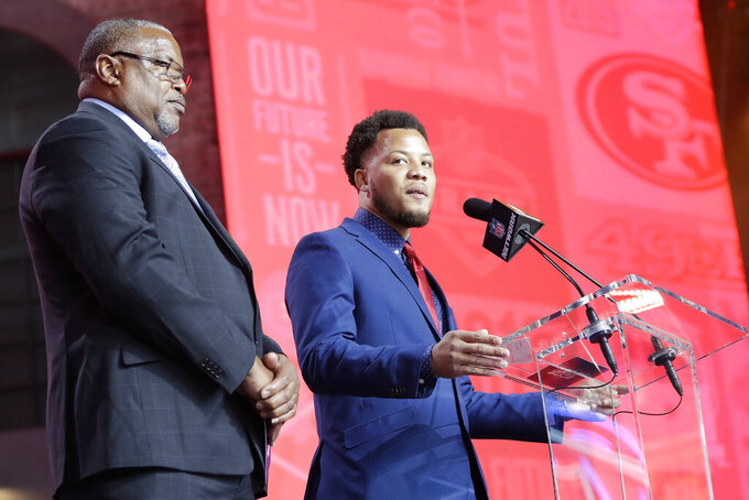 DeMarcus Cobb, son of former NFL player and scout Reggie Cobb, announces the pick by the San Francisco 49ers of South Carolina wide reciever Deebo Samuel during the the second round of the NFL football draft, Friday, April 26, 2019, in Nashville, Tenn. (AP Photo/Mark Humphrey)