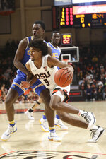 Oregon State's Ethan Thompson slips past UCLA's Kris Wilkes during the first half of an NCAA college basketball game in Corvallis, Ore., Sunday, Jan. 13, 2019. (AP Photo/Amanda Loman)