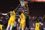 Saint Louis' Jordan Goodwin (0) goes up to the basket against Minnesota's Marcus Carr (5) during an NCAA college basketball game, Sunday, Dec. 20, 2020, in Minneapolis. Minnesota won 90-82. (AP Photo/Stacy Bengs)