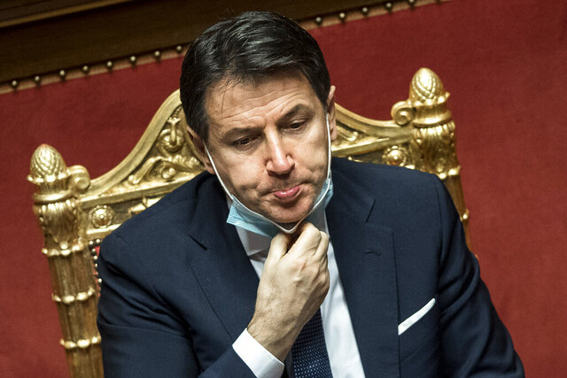 Italian Prime Minister Giuseppe Conte speaks during his final address at the Senate prior to a confidence vote, in Rome, Tuesday, Jan. 19, 2021. Italian Premier Giuseppe Conte fights for his political life with an address aimed at shoring up support for his government, which has come under fire from former Premier Matteo Renzi's tiny but key Italia Viva (Italy Alive) party over plans to relaunch the pandemic-ravaged economy. (Roberto Monaldo/ Lapresse via AP)