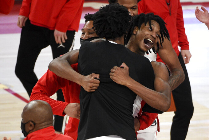 Houston guard Tramon Mark, right, celebrates his game-winning 3-point basket during the second half of an NCAA college basketball game against Memphis, Sunday, March 7, 2021, in Houston. (AP Photo/Eric Christian Smith)