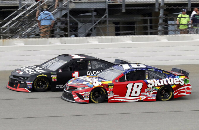 Kurt Busch, left, and Kyle Busch compete during a NASCAR Cup Series auto race at Chicagoland Speedway in Joliet, Ill., Sunday, June 30, 2019. (AP Photo/Nam Y. Huh)