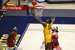 West Virginia forward Oscar Tshiebwe (34) shoots while defended by Richmond forward Grant Golden (33) during the first half of an NCAA college basketball game Sunday, Dec. 13, 2020, in Morgantown, W.Va. (AP Photo/Kathleen Batten)