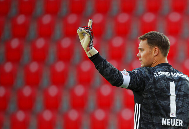 Munich's goal keeper Manuel Neuer gestures during the German Bundesliga soccer match between Union Berlin and Bayern Munich in Berlin, Germany, Sunday, May 17, 2020. The German Bundesliga becomes the world's first major soccer league to resume after a two-month suspension because of the coronavirus pandemic. (AP Photo/Hannibal Hanschke, Pool)