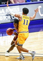 Elon guard Darius Burford (12) drives to the basket against Drexel guard Camren Wynter (11) during the first half of an NCAA college basketball game for the Colonial Athletic Association men's tournament championship in Harrisonburg, Va., Tuesday, March 9, 2021. (AP Photo/Daniel Lin)