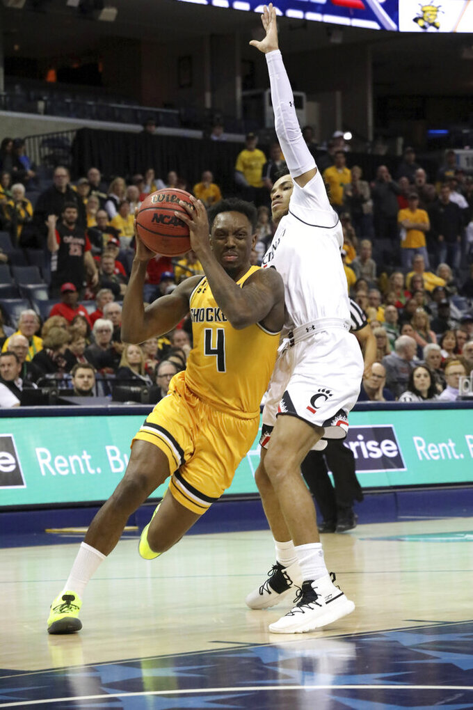 Wichita State's Samajae Haynes-Jones presses to the basket as Cincinnati player Cane Broome defends in the second half of an NCAA college basketball game at the American Athletic Conference tournament Saturday, March 16, 2019, in Memphis, Tenn. (AP Photo/Troy Glasgow)