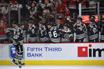 Chicago Blackhawks' Zack Smith (15) celebrates with teammates on the bench after scoring during the first period of an NHL hockey game against the Colorado Avalanche Friday, Nov. 29, 2019, in Chicago. (AP Photo/Paul Beaty)