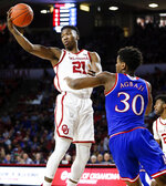 Oklahoma forward Kristian Doolittle (21) grabs a rebound next to Kansas guard Ochai Agbaji (30) in the first half of an NCAA college basketball game in Norman, Okla., Tuesday, March 5, 2019. (AP Photo/Nate Billings)