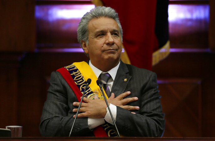 FILE - In this May 24, 2018 file photo, Ecuador's President Lenin Moreno delivers his first, annual state-of-the-nation address inside the National Assembly in Quito, Ecuador. Moreno said in a radio interview Thursday, Dec. 6, 2018, that Britain has provided sufficient guarantees for Assange to leave his government's embassy in London, where the WikiLeaks founder has been living under asylum since 2012. (AP Photo/Dolores Ochoa, File)