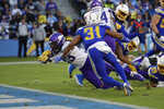 Minnesota Vikings running back Mike Boone scores a touchdown during the second half of an NFL football game against the Los Angeles Chargers,. Sunday, Dec. 15, 2019, in Carson, Calif. (AP Photo/Marcio Jose Sanchez)