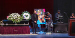 """People attend the funeral services for the late Marcel Theo Hall, aka """"Biz Markie"""" at the Patchogue Theater for the Performing Arts on Monday, Aug. 2, 2021 in Patchogue, NY. (Alejandra Villa Loarca/Newsday via AP)"""
