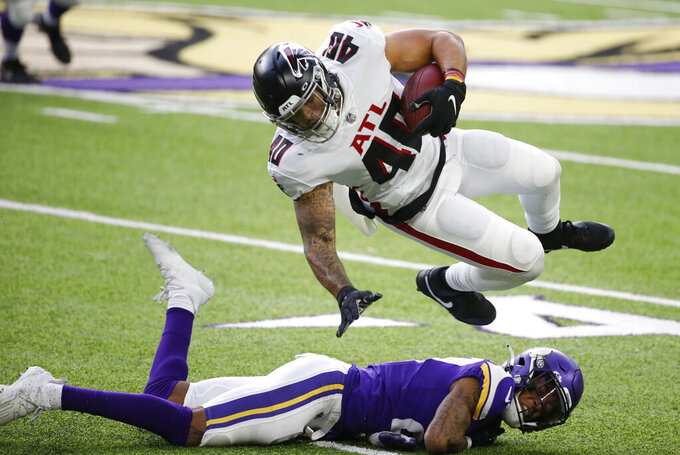 Atlanta Falcons fullback Keith Smith (40) is tackled by Minnesota Vikings cornerback Cameron Dantzler after catching a pass during the first half of an NFL football game, Sunday, Oct. 18, 2020, in Minneapolis. (AP Photo/Bruce Kluckhohn)