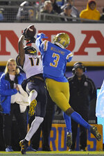 UCLA defensive back Rayshad Williams, right, breaks up a pass in the end zone intended for California wide receiver Makai Polk during the second half of an NCAA college football game Saturday, Nov. 30, 2019, in Pasadena, Calif. California won 28-18. (AP Photo/Mark J. Terrill)