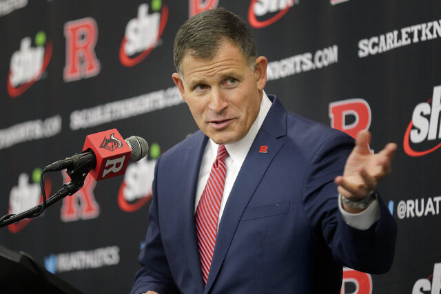 FILE - In this Dec. 4, 2019, file photo, new Rutgers NCAA college football head coach Greg Schiano speaks at an introductory news conference in Piscataway, N.J. Rutgers is scheduled to begin their season against Michigan State on Oct. 24, 2020. (AP Photo/Seth Wenig, File)