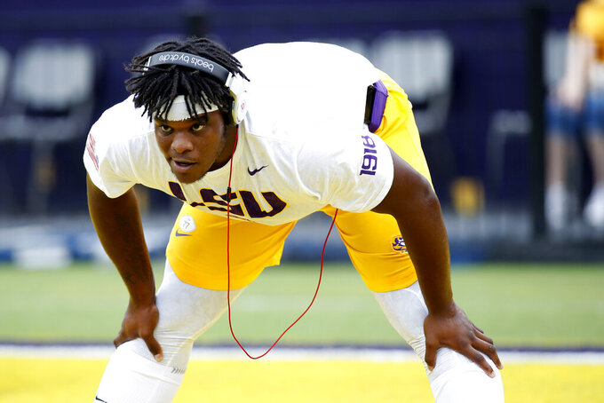 FILE - In this Oct. 20, 2018, file photo, LSU offensive tackle Saahdiq Charles (77) is shown before an NCAA college football game, in Baton Rouge, La. LSU coach Ed Orgeron says projected starting left tackle Saahdiq Charles and pass-rushing linebacker Michael Divinity Jr. are set to play when the sixth-ranked Tigers visit No. 9 Texas on Saturday. (AP Photo/Tyler Kaufman, File)