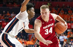 Wisconsin guard Brad Davison (34) protects the ball from Illinois guard Trent Frazier (1) during the second half of an NCAA college basketball game in Champaign, Ill., Wednesday, Jan. 23, 2019. (AP Photo/Stephen Haas)