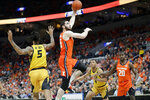 Illinois' Giorgi Bezhanishvili (15) heads to the basket past Missouri's Mitchell Smith (5) during the first half of an NCAA college basketball game Saturday, Dec. 21, 2019, in St. Louis. (AP Photo/Jeff Roberson)