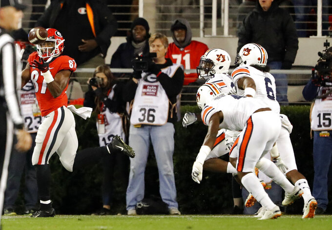 Georgia wide receiver Tyler Simmons (87) catches a pass for a touchdown during the first half of an NCAA college football game against Auburn, Saturday, Nov. 10, 2018, in Athens, Ga. (AP Photo/John Bazemore)