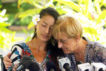 FILE - In this May 28, 2019, file photo, rescued hiker Amanda Eller, left, embraces her mother, Julia Eller, before a news conference begins at Maui Memorial Hospital in Wailuku, Hawaii. Amanda Eller said she fell to the ground and started bawling when a rescue helicopter spotted her in a forest where she had survived for two weeks by eating plants and drinking stream water. (Craig T. Kojima/Honolulu Star-Advertiser via AP, File)