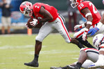 Georgia defensive back Richard LeCounte III (2) scopes up a fumble during the first half of an NCAA college football game between Georgia and Florida at in Jacksonville, Fla. Saturday, Oct. 27, 2018. (Joshua L. Jones/Athens Banner-Herald via AP)