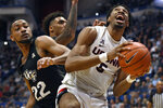 Connecticut's Isaiah Whaley (5) pulls down a rebound against Central Florida's Darin Green Jr.(22) in the first half of an NCAA college basketball game, Wednesday, Feb. 26, 2020, in Hartford, Conn. (AP Photo/Jessica Hill)