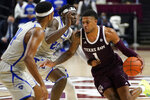 Texas A&M guard Savion Flagg (1) drives the lane against New Orleans forward LaDarius Marshall (23) during the second half of an NCAA college basketball game Sunday, Nov. 29, 2020, in College Station, Texas. (AP Photo/Sam Craft)