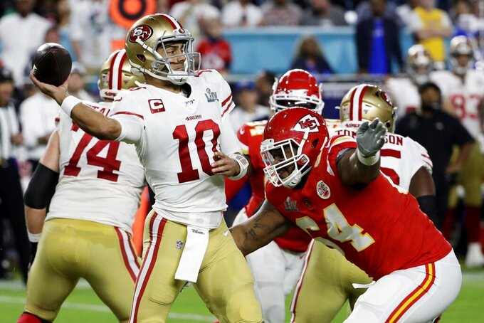 San Francisco 49ers quarterback Jimmy Garoppolo (10) is pressured by Kansas City Chiefs' Mike Pennel (64) during the first half of the NFL Super Bowl 54 football game Sunday, Feb. 2, 2020, in Miami Gardens, Fla. (AP Photo/Seth Wenig)