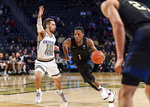 Pittsburgh guard Xavier Johnson (1) drives to the basket as Georgia Tech guard Jose Alvarado (10) defends during the second half of an NCAA college basketball game Wednesday, Feb. 20, 2019, in Atlanta. Georgia Tech won 73-65. (AP Photo/Danny Karnik)