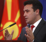 Macedonian Prime Minister Zoran Zaev addresses the media during a news conference held at a government building in Skopje, Macedonia, Saturday, Jan. 12, 2019. Macedonia late Friday fulfilled its part of a historic deal that will pave its way to NATO membership and normalize relations with neighboring Greece, after lawmakers approved constitutional changes to rename the country North Macedonia. (AP Photo/Boris Grdanoski)
