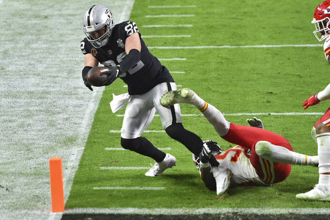 Las Vegas Raiders tight end Jason Witten (82) scores a touchdown around Kansas City Chiefs defensive end Tanoh Kpassagnon (92) during the second half of an NFL football game, Sunday, Nov. 22, 2020, in Las Vegas. (AP Photo/David Becker)