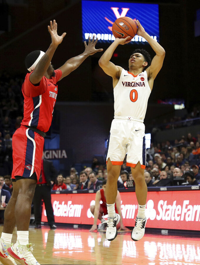 Virginia guard Kihei Clark (0) shoots over Stony Brook guard Makale Foreman (1) during an NCAA college basketball game in Charlottesville, Va., Wednesday, Dec. 18, 2019. Virginia won 56-44. (AP Photo/Andrew Shurtleff)