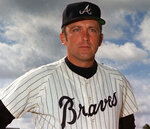 FILE - In this 1970 file photo, Atlanta Braves' Phil Niekro poses for a photo. Niekro, who pitched well into his 40s with a knuckleball that baffled big league hitters for more than two decades, mostly with the Braves, has died after a long fight with cancer, the team announced Sunday, Dec. 27, 2020. He was 81. (AP Photo/File)