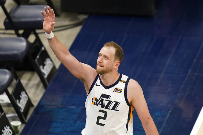 Utah Jazz guard Joe Ingles (2) waves to the crowd following the team's NBA basketball game against the Indiana Pacers on Friday, April 16, 2021, in Salt Lake City. (AP Photo/Rick Bowmer)