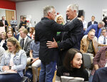 Jon Huntsman Jr., left, embraces long time friend Don Olsen prior to speaking during a forum at the Michael O. Leavitt Center for Politics and Public Service at Southern Utah University  in Cedar City, Utah, Thursday, Nov. 14, 2019. Huntsman, a former Utah governor, one-time presidential candidate and ambassador to China and Russia, announced Thursday he will run for Utah governor again in 2020. (Steve Griffin/The Deseret News via AP)