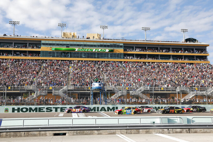 Cars get the green flag at the start of the NASCAR Cup Series Championship auto race at the Homestead-Miami Speedway, Sunday, Nov. 18, 2018, in Homestead, Fla. (AP Photo/Terry Renna)