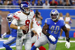 New York Giants quarterback Daniel Jones (8) scrambles during the first half of an NFL football game against the Detroit Lions, Sunday, Oct. 27, 2019, in Detroit. (AP Photo/Rick Osentoski)