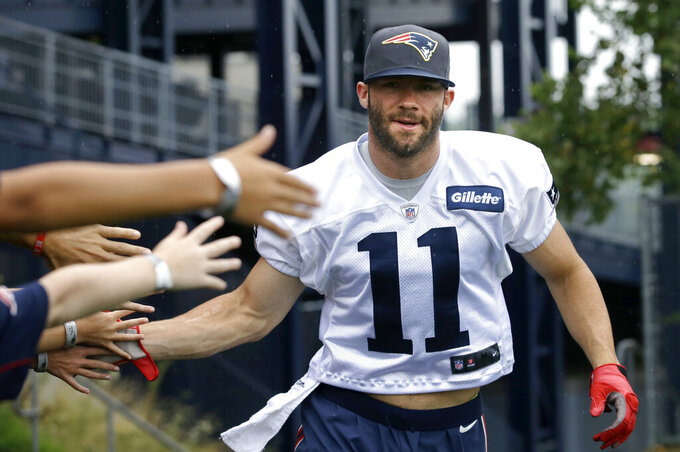 FILE - In this July 31, 2016, file photo, New England Patriots wide receiver Julian Edelman greets fans as he steps on the field before an NFL football training camp practice in Foxborough, Mass. Citing a knee injury that cut his 2020 season short after just six games, Edelman announced Monday, April 12, 2021, that he is retiring from the NFL after 11 seasons. (AP Photo/Steven Senne, File)