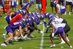Led by quarterback Jake Browning, in red,, the Minnesota Vikings offense practices against the defense during NFL football training camp Wednesday, July 28, 2021, in Eagan, Minn. (AP Photo/Bruce Kluckhohn)