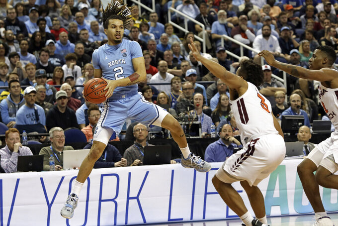 North Carolina guard Cole Anthony (2) looks to pass while Virginia Tech guard Wabissa Bede (3) defends during the first half of an NCAA college basketball game at the Atlantic Coast Conference tournament in Greensboro, N.C., Tuesday, March 10, 2020. (AP Photo/Ben McKeown)