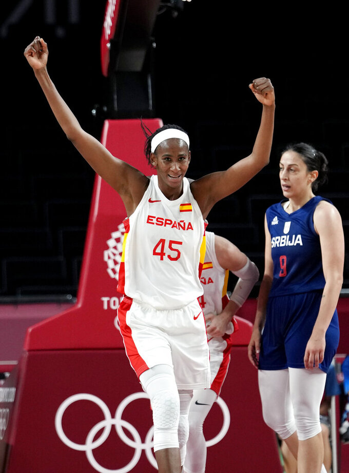 Spain's Astou Ndour (45) celebrates past Serbia's Jelena Brooks (9) during their win in a women's basketball game at the 2020 Summer Olympics, Thursday, July 29, 2021, in Saitama, Japan. (AP Photo/Eric Gay)