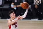 Miami Heat guard Tyler Herro (14) goes up for a shot during the first half of Game 2 of basketball's NBA Finals against the Los Angeles Lakers on Friday, Oct. 2, 2020, in Lake Buena Vista, Fla. (AP Photo/Mark J. Terrill)
