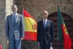 Spain's King Felipe VI, left, and Portugal's President Marcelo Rebelo de Sousa adjust their face masks during a ceremony to mark the reopening of the Portugal/Spain border in Elvas, Portugal, Wednesday, July 1, 2020. The border was closed for three and a half months due to the coronavirus pandemic. (AP Photo/Armando Franca)